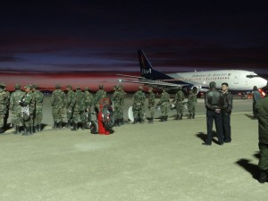 Das Flugzeug mit den Journalisten ist gelandet. Militär und Journalisten warten auf den Präsidenten.