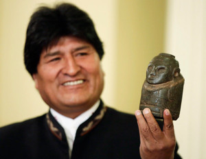 Bolivia's President Evo Morales holds a fertility statue as he speaks during a news conference at the presidential palace in La Paz